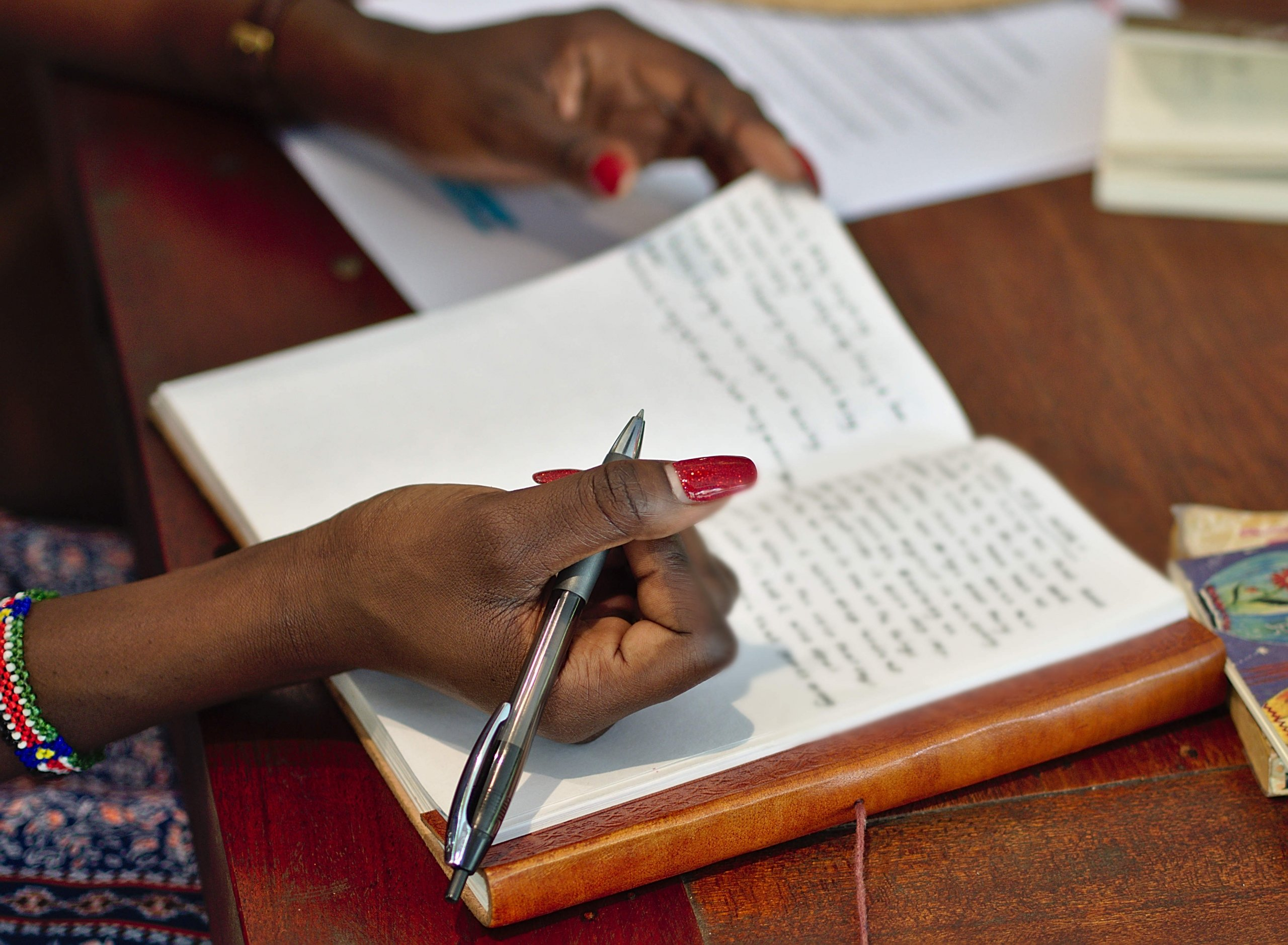 Writing and Yoga Retreat Vietnam - Flora scribbling away in her beautiful leather bound journal